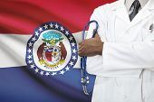 Concept Of National Healthcare System - Missouri flag on background
