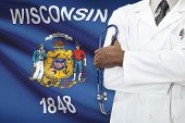 Concept Of National Healthcare System - Wisconsin flag on background