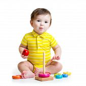 baby boy playing with colorful toy