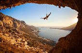 picture of fail-safe  - Silhouette of a rock climber falling of a cliff while lead climbing - JPG