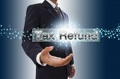 Businessman hand showing tax refund button