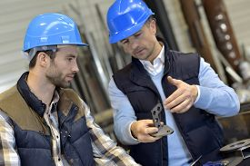 foto of production  - Engineer with mechanical worker checking on production - JPG