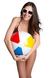 picture of beach-ball  - Smiling happy sunglasses girl holding beach ball - JPG