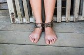 foto of interpreter  - Child was gets foot interpreter by the chains - JPG
