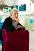 pic of striking  - businesswoman waiting for her departure at the airport - JPG