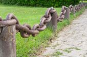 stock photo of chain link fence  - Fence from former rusty barge anchor chain - JPG