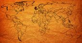 stock photo of flags world  - united kingdom flag on old vintage world map with national borders - JPG