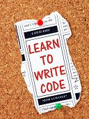 pic of newspaper  - Classified advertising newspaper clipping with the phrase Learn To Write Code in red text and pinned to a cork notice board - JPG