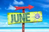 picture of directional  - June direction sign with beach background - JPG