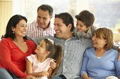 stock photo of extend  - Portrait Of Extended Hispanic Family Relaxing At Home - JPG