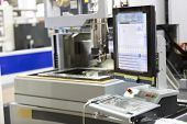 stock photo of cut  - CNC wire cut machine cutting high precision mold parts - JPG