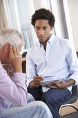 stock photo of counseling  - Middle Aged Man Having Counselling Session - JPG