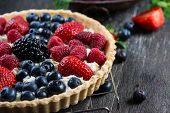 picture of tarts  - Homemade tart with fresh berries summer fruit on rustic table - JPG
