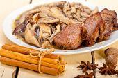 image of deer meat  - venison deer game filet tenderloin and fresh wild mushrooms - JPG