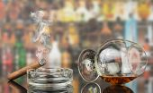 picture of cigar  - Glass of cognac with cigar on blurred background - JPG
