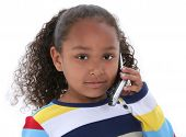 Beautiful Six Year Old Girl Speaking On Cellphone Over White