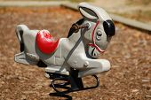 stock photo of buckaroo  - Vintage donkey buckaroo set in a sunlit playground - JPG