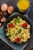 foto of scrambled eggs  - healthy breakfastfrying scramble eggs and grilled vegetables - JPG