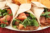stock photo of mexican food  - colorful mexican fajitas and crunchy nacho chips - JPG