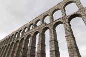picture of aqueduct  - an old stone aqueduct in Segovia Spain - JPG