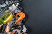 picture of catch fish  - Fresh catch whole fish and seafood on ice cooking concept - JPG