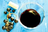 picture of wine grapes  - Glass of red wine on old plank - JPG