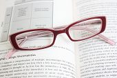 Glasses Laying On A Book