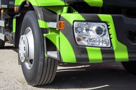 stock photo of trucks  - Trailer truck DSLR photography truck heavy freight transportation of large cargoes modern truck truck cab bright paint horizontal image the wheel of the truck the optical lamp on the truck - JPG