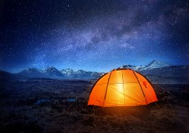 image of glow  - A camping tent glows under a night sky full of stars - JPG
