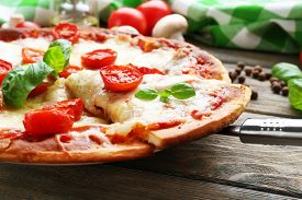 picture of black-cherry  - Delicious pizza with cheese and cherry tomatoes on wooden table - JPG