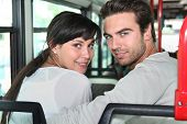 Couple sitting in a city bus