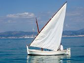Boat with a white sail. Malorca. Spain
