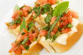 Tomato, Basil And Mozzarella Bruchetta Isolated On White