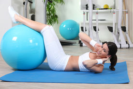 pic of cardio exercise  - Young woman doing gymnastics - JPG