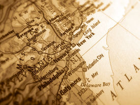picture of usa map  - a sepia photo of an atlas map of new york - JPG