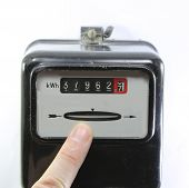 Index Finger Indicating The Consumption Of Electricity On A Electricity Meter On White Background poster