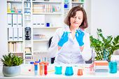 Female Scientist Injects Reagent Into The Plant In A Laboratory. Researcher Researching In The Labor poster
