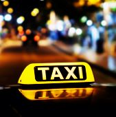 Taxi Sign On The Roof Of A Taxi At Night Close-up poster