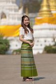 Beautiful Woman Thai Traditional Culture, Asian Woman Wearing Traditional Thai Culture At Countrysid poster