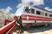 stock photo of motor coach  - Class A RV Coach That Crashed Into A Stone Wall - JPG