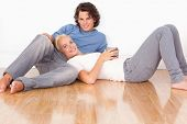 Young couple sitting together on the floor