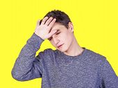 A Tired Man Stressed Sweating With A Headache Fever Isolated Against A Yellow Wall Background. The T poster