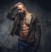 Portrait Of Modern Bearded Male In Denim Jeans And Casual Jacket Dressed On Naked Torso. poster