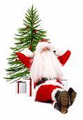 Santa Claus Against A Xmas Tree