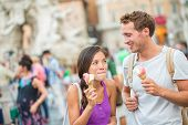 Ice cream summer fun couple eating gelato in Rome on Piazza Navona. Happy people having fun eating i poster