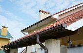 Close Up View On House Roof Areas For Rain Gutter Waterproofing Outdoor. Home Guttering, Gutters, Pl poster
