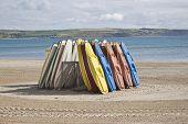 Kayaks Stood Up On The Beach