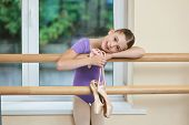 Adorable Little Ballerina With Pointe Shoes. Beautiful Little Ballet Dancer Leaning On Barre At Ball poster