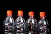 Four Closed Plastic Bottles