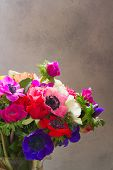 Fresh Anemones And Roses Blooming Flowers Bouquet Close Up On Gray Background With Copy Space poster